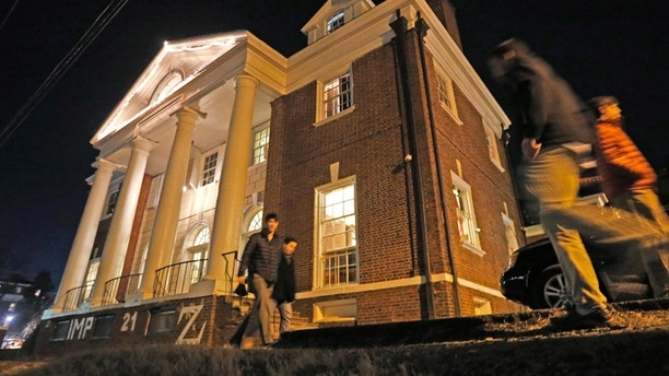 """FILE- In this Jan. 15, 2015 file photo shows students participate in rush pass by the Phi Kappa Psi house at the University of Virginia in Charlottesville, Va. The house was depicted in a debunked Rolling Stone story as the site of a rape in September of 2012. A defamation trial against the magazine is set to begin on Monday, Oct. 17, 2016, over its article about """"Jackie"""" and her harrowing account of being gang raped in a fraternity initiation. (AP Photo/Steve Helber, File)"""