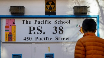 A yellow nuclear fallout shelter sign is seen hung over the entrance to P.S. 38 in the Brooklyn borough of New York, U.S., December 7, 2017. Picture taken December 7, 2017.   REUTERS/Brendan McDermid - RC1B6A31A0D0