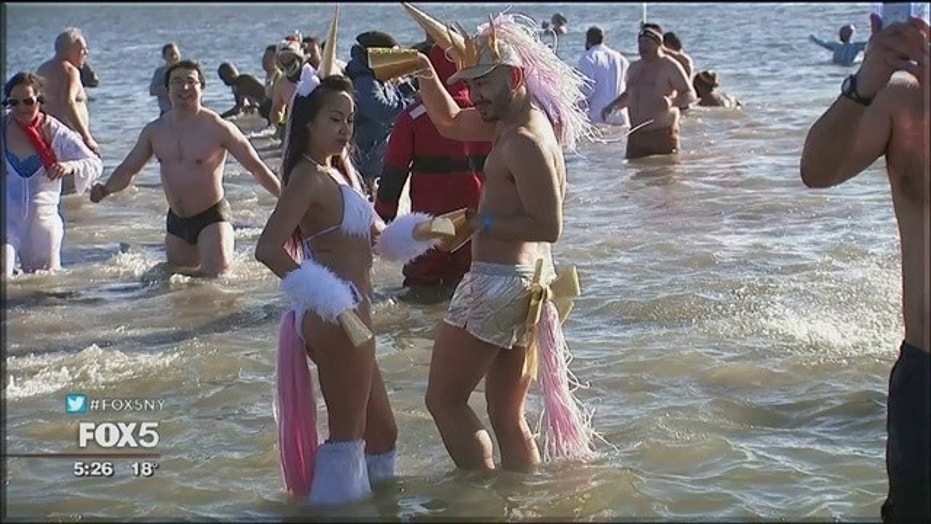 Frigid temperatures did not faze the Coney Island Polar Bear Club, who braved the sub-zero wind chills to sprint into the ocean New Year's Day.
