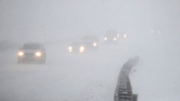 Vehicles commute southbound on the Garden State Parkway in whiteout conditions during a snowstorm, Thursday, Jan. 4, 2018, in Eatontown, N.J. Residents across a huge swath of the U.S. awakened Thursday to the beginnings of a massive winter storm expected to deliver snow, ice and high winds followed by possible record-breaking cold as it moves up the Eastern Seaboard from the Carolinas to Maine. (AP Photo/Julio Cortez)