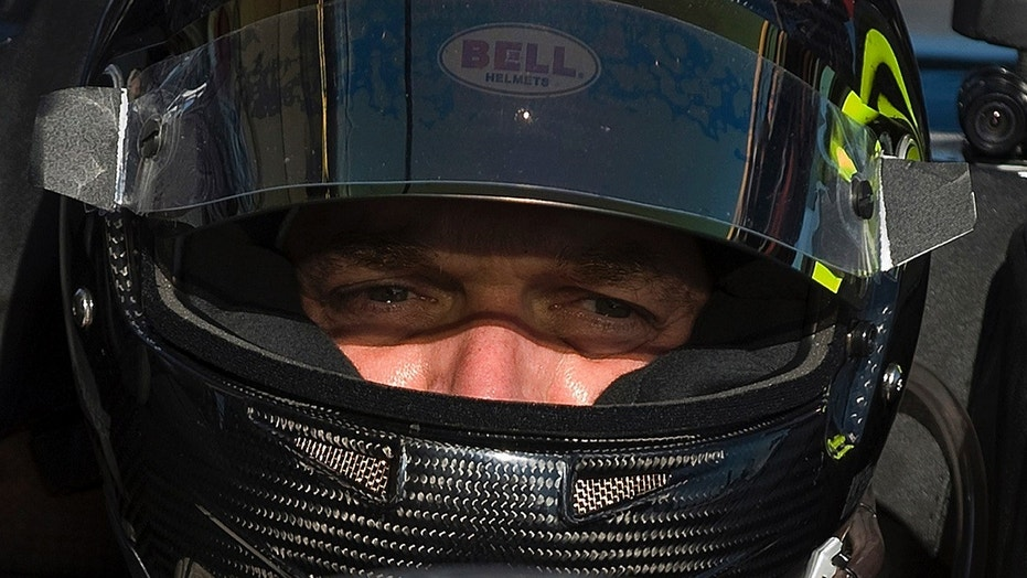 Scott Tucker takes a break during a morning practice session for an auto race in Sebring, Fla., March 19, 2010.