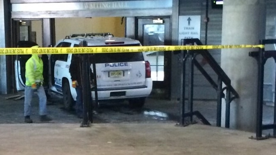 A person stole a New Jersey Transit police SUV and crashed it into the doors of the Hoboken terminal, officials said.