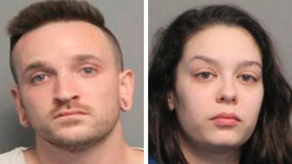Louisiana police said they arrested a couple after an alleged robbery attempt in which the woman reportedly was topless and kissed her Uber driver as a distraction before her boyfriend reportedly brandished a knife.