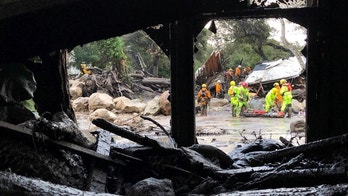 Emergency personnel search through debris and damaged homes after a mudslide in Montecito, California, U.S. in this photo provided by the Santa Barbara County Fire Department, January 9, 2018.   Mike Eliason/Santa Barbara County Fire Department/Handout via REUTERS     ATTENTION EDITORS - THIS IMAGE WAS PROVIDED BY A THIRD PARTY. - RC1C05685160