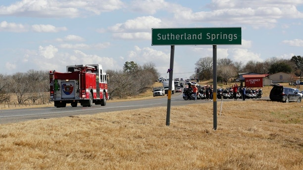 Ryland Ward, who was shot during a Nov. 5 church shooting, passes well wishers and first responders as he returns home after his release from the hospital while riding in the cab of a fire engine, Thursday, Jan. 11, 2018, in Sutherland Springs, Texas. Ward, 6, was shot several times and was the last victim still hospitalized following the church massacre in South Texas. (AP Photo/Eric Gay)