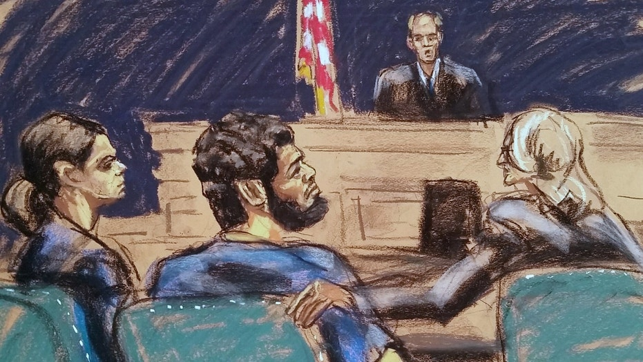 Akayed Ullah, center, listens to U.S. District Court Judge Richard J. Sullivan as he is arraigned in last month's failed bombing of the New York City subway
