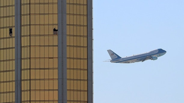 Air Force One departs Las Vegas past the broken windows on the Mandalay Bay hotel, where shooter Stephen Paddock conducted his mass shooting along the Las Vegas Strip in Las Vegas, Nevada, U.S., October 4, 2017. REUTERS/Mike Blake TPX IMAGES OF THE DAY - RC1A1B55D970