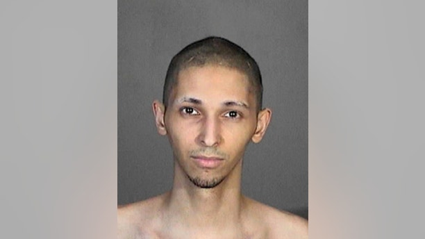 This 2015 booking photo released by the Glendale, Calif., Police Department shows Tyler Raj Barriss. The Los Angeles Police Department confirms it arrested Barriss Friday, Dec. 29, 2017, in connection with a deadly 'swatting' call in Wichita, Kan., Thursday, Dec. 28. Information from Glendale shows that in October, 2015, Barriss was arrested in connection with making a bomb threat to ABC Studios in Glendale. (Glendale Police Department via AP)