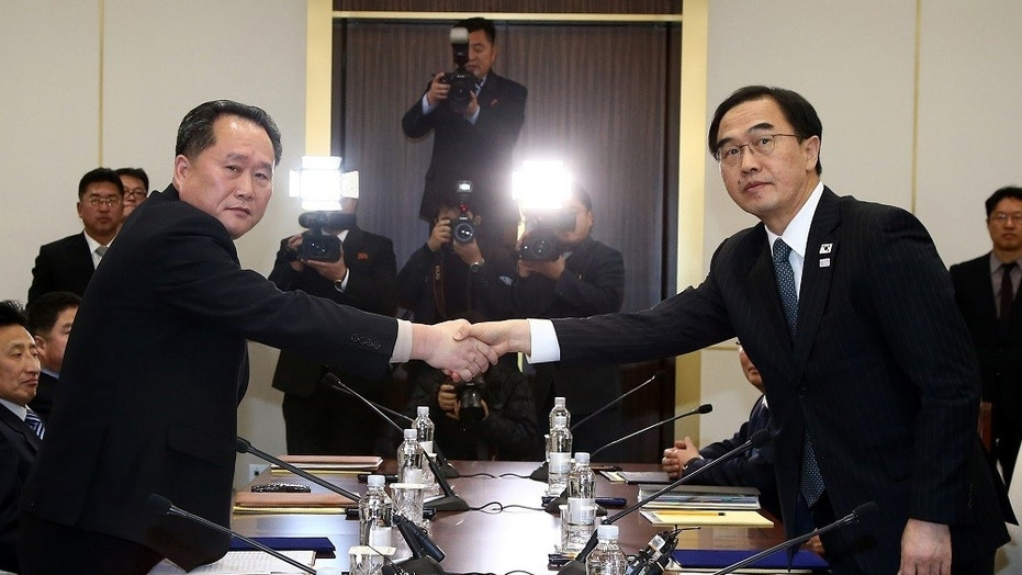 South Korean Unification Minister Cho Myoung-gyon, right, shakes hands with the head of North Korean delegation, Ri Son Gwon, during their meeting at the Panmunjom in the Demilitarized Zone in Paju, South Korea, Jan. 9, 2018.