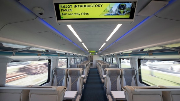 One of the passenger compartments of a Brightline train is shown as the train heads to Fort Lauderdale Fla. Thursday Jan. 11 2018 near West Palm Beach Fla. The Brightline train will begin introductory service on Saturday with round-trip fares start