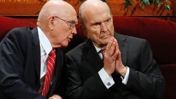 FILE - In this Sept. 30, 2017, file photo, Dallin H. Oaks, left, and Russell M. Nelson, members of a top governing body called the Quorum of the Twelve Apostles of The Church of Jesus Christ of Latter-day Saints, talk during the two-day Mormon church conference in Salt Lake City. Nelson has been officially named the faith's president on Tuesday, Jan. 16, 2018. (AP Photo/Rick Bowmer, File)