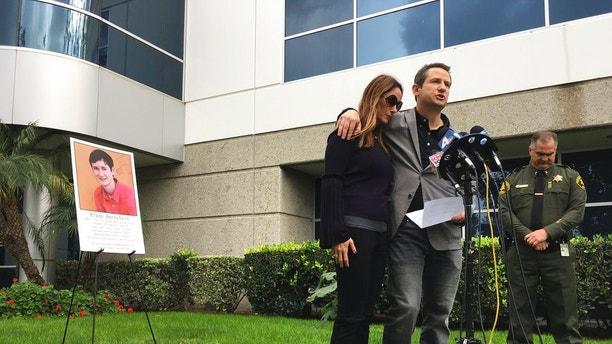 Gideon and Jeanne Bernstein, parents of missing teen Blaze, pictured left, are joined by Orange County Sheriff's Lt. Brad Valentine, right, during a news conference in Lake Forest, Calif., Wednesday, Jan. 10, 2018, The body of the University of Pennsylvania student who went missing on Jan. 2, while home in Southern California on winter break has been found, and his death is being investigated as a homicide, authorities said on Wednesday. (AP Photo/Amy Taxin)