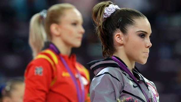 Aug. 5, 2012: U.S. gymnast McKayla Maroney, right, stand along with Romania's gymnast Sandra Raluca Izbasa during the podium ceremony for the artistic gymnastics women's vault finals at the 2012 Summer Olympics in London.