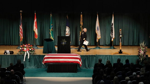 Pierce County Sheriff Paul Pastor walks away after speaking during a memorial service for slain Pierce County Sheriff's Deputy Daniel McCartney, Wednesday, Jan. 17, 2018, at Pacific Lutheran University in Tacoma, Wash. McCartney died the night of Sunday, Jan. 7, 2018, after being shot while responding to a to a break-in call southeast of Tacoma. (AP Photo/Ted S. Warren, Pool)