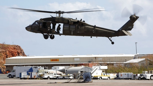 A U.S. Army UH-60 Black Hawk helicopter rises after setting disaster relief supplies down on the tarmac at Cyril E. King Airport in Charlotte Amalie, St. Thomas, U.S. Virgin Islands September 16, 2017.  REUTERS/Jonathan Drake - RC1BFE148340