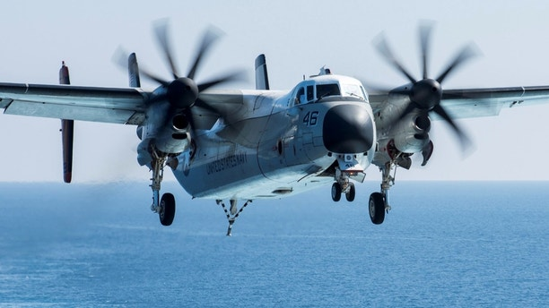 FILE PHOTO: A C-2A Greyhound logistics aircraft prepares to land on the flight deck of the aircraft carrier USS George H.W. Bush in the Mediterranean Sea March 7, 2017.  Mass Communication Specialist 3rd Class Christopher Gaines/U.S. Navy/Handout via REUTERS   ATTENTION EDITORS - THIS IMAGE WAS PROVIDED BY A THIRD PARTY - RC1C082CC780