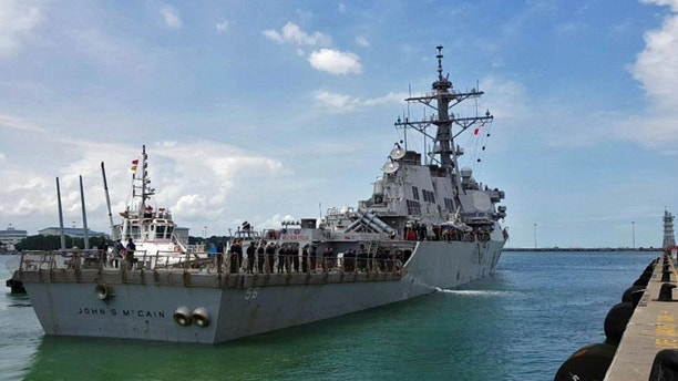 The guided missile destroyer The USS John S. McCain arrives at Changi Naval Base in Singapore on August 21, 2017 in this brochure, courtesy of the US Navy. UU US Navy UU / Brochure through REUTERS ATTENTION EDITORS: THIS IMAGE HAS BEEN SUPPLIED BY A THIRD PARTY. - RC1D24AFC2F0