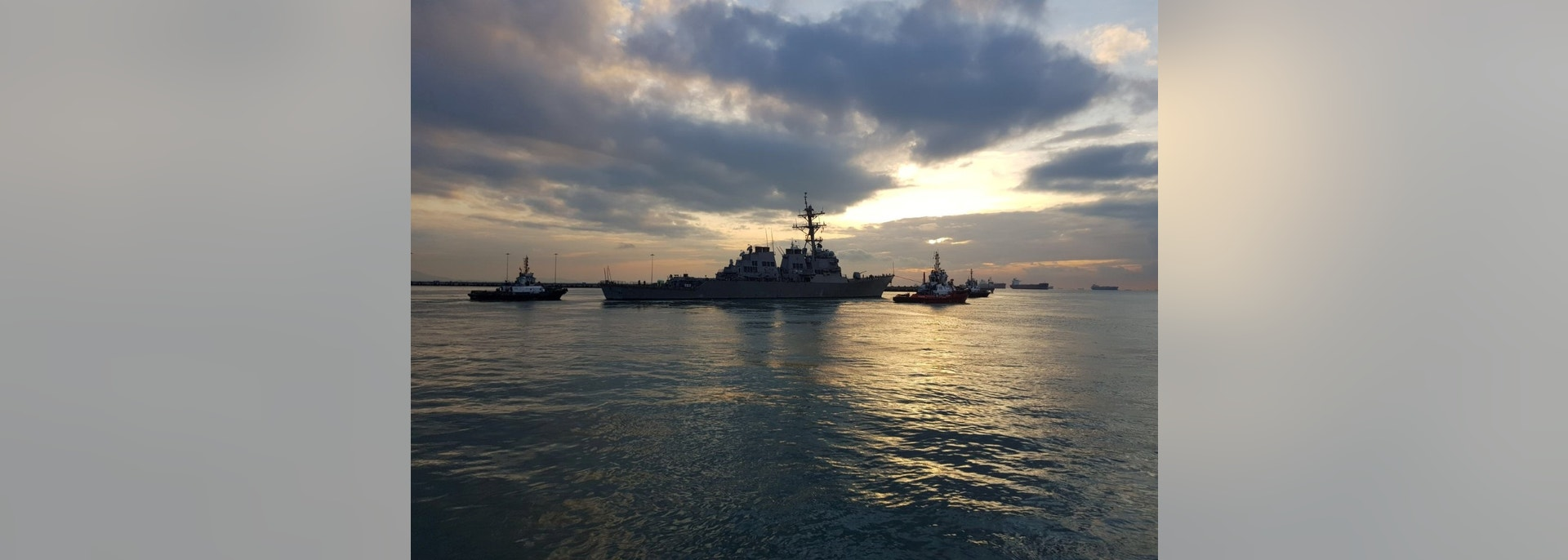 Arleigh Burke-class guided missile destroyer USS John S. McCain (DDG 56) is towed away from the pier at Changi Naval Base in Singapore to meet heavy lift transport vessel MV Treasure on route to Fleet Activities Yokosuka for repairs, October 5, 2017. Mass Communication Specialist 1st Class Micah Blechner/U.S. Navy Handout via REUTERS   ATTENTION EDITORS - THIS IMAGE WAS PROVIDED BY A THIRD PARTY. - RC1A5D2862E0