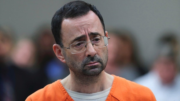 In this Nov. 22, 2017 file photo, Dr. Larry Nassar, 54, appears in court for a plea hearing in Lansing, Mich. Nasser, a sports doctor accused of molesting girls while working for USA Gymnastics and Michigan State University pleaded, guilty to multiple charges of sexual assault and will face at least 25 years in prison.(AP Photo/Paul Sancya)