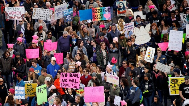 People participate in the second annual Women's March in Los Angeles, California, U.S. January 20, 2018. REUTERS/Patrick T. Fallon - RC11A5F5D510
