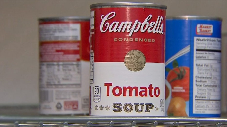 A Massachusetts couple accidentally donated a fake Campbell's Tomato Soup Can with $2,500 to a local soup kitchen, according to their daughter.