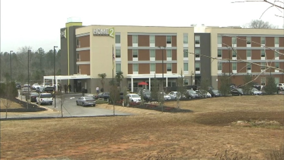 A \ distressed\  man walked into a Georgia hotel with an assault rifle and fired & Man in Georgia arrested for allegedly shooting glass door to hotel ...