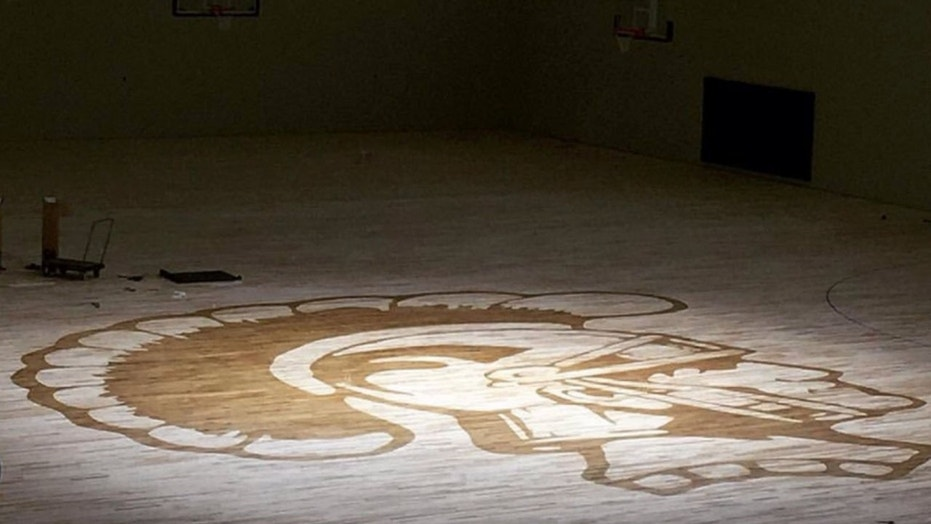 The Kelly Walsh High School's Trojan logo on the gym floor. A freshman student left the school after he was reportedly waterboarded by members of the wrestling team.