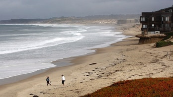 Beach goers ingnore the beach closure signs posted at Monterey State Beach Monday, Jan. 22, 2018, after sewage spilled into Monterey Bay in Monterey, Calif. Nearly 5 million gallons of sewage spilled into the ocean in Monterey County after a filter at a water treatment plant got clogged and the computer system failed to sound an alarm, an official said Monday. The spill at the facility in the city of Marina started Friday night and an operator stopped it about eight hours later on Saturday morning. (Vern Fisher/Monterey Herald via AP)