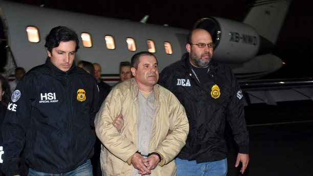 "FILE - In this Jan. 19, 2017 file photo provided U.S. law enforcement, authorities escort Joaquin ""El Chapo"" Guzman, center, from a plane to a waiting caravan of SUVs at Long Island MacArthur Airport, in Ronkonkoma, N.Y. U.S. prosecutors and lawyers for infamous drug lord Guzman are sparring over his tough jail conditions. The government responded in court papers Tuesday, March 21, 2017, by saying the restrictions are appropriate for someone known for escaping twice from prison in Mexico. (U.S. law enforcement via AP, File)"