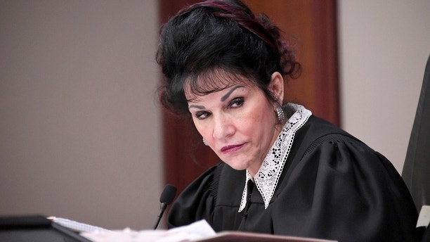Judge Rosemarie Aquilina listens to Abigayle Bergeron's victim statement during the sixth day of Larry Nassar's sentencing hearing Tuesday, Jan. 23, 2018, in Lansing, Mich. Nassar has admitted sexually assaulting athletes when he was employed by Michigan State University and USA Gymnastics, which is the sport's national governing organization and trains Olympians. (Dale G. Young/Detroit News via AP)