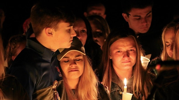 People attend a vigil for the victims of a fatal shooting at Marshall County High School on Thursday, January 25, 2018 at Mike Miller County Park. Benton, Ky. The 15-year-old, accused of fatal shooting on Tuesday, which left more than a dozen wounded, was ordered on Thursday on preliminary charges of murder and assault. (AP Photo / Robert Ray)