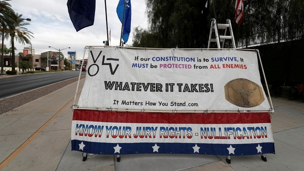 A sign is shown outside the federal courthouse as jury selection begins for Nevada rancher Cliven Bundy, two of his sons and co-defendant Ryan Payne, in Las Vegas, Nevada, U.S. October 30, 2017. REUTERS/Las Vegas Sun/Steve Marcus - RC1E19ED98A0