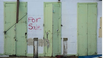 his Friday, Jan. 19, 2018 photo, shows one of multiple properties located in the Esperanza sector that are currently for sale, in Vieques, Puerto Rico. Hundreds of thousands of Puerto Ricans face losing their homes upon the expiration of a three-month moratorium on mortgage payments that banks offered after Hurricane Maria devastated the island. (AP Photo/Carlos Giusti)
