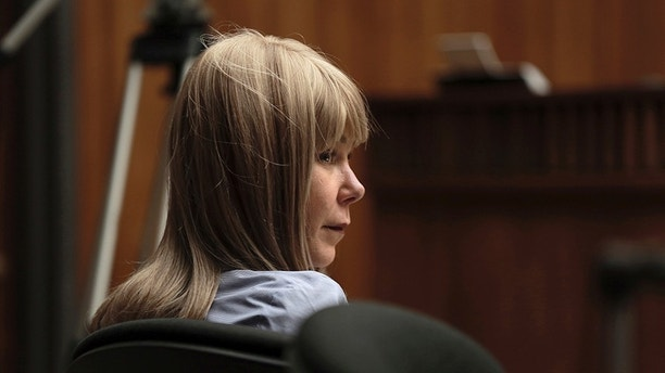 FILE - In this Wednesday, Jan. 31, 2018 file photo, Alexandria Duval listens to testimony during her murder trial in Wailuku, Hawaii. Duval, who was accused of deliberately driving off a Hawaii cliff and killing her identical twin sister, has been acquitted of murder. A judge on Maui found Alexandria Duval not guilty Thursday, Feb. 1, 2018. Duval opted to have a judge instead of a jury decide the case. The sisters were seen arguing on the narrow, winding Hana Highway on the island of Maui before their SUV plunged 200 feet over a cliff in 2016. (Chris Sugidono/The News via AP)