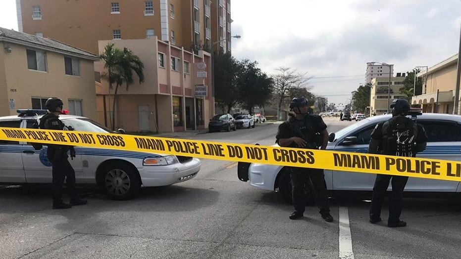 "A hostage situation was under way at a restaurant in Miami on Monday afternoon, with management ""holding employees and some patrons hostage,"" police said."