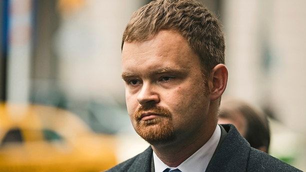 FILE - In this Dec. 20, 2017, file photo, Brandon Bostian, the Amtrak engineer involved in a 2015 derailment in Philadelphia that killed eight people and injured more than 200, departs after a hearing at the Criminal Justice Center in Philadelphia. During a Tuesday, Feb. 6, 2018, hearing, prosecutors were set to argue that charges should be reinstated against Bostian, after involuntary manslaughter charges were thrown out Sept. 12, 2017, by a judge who determined the evidence pointed to an accident. (AP Photo/Matt Rourke, File)