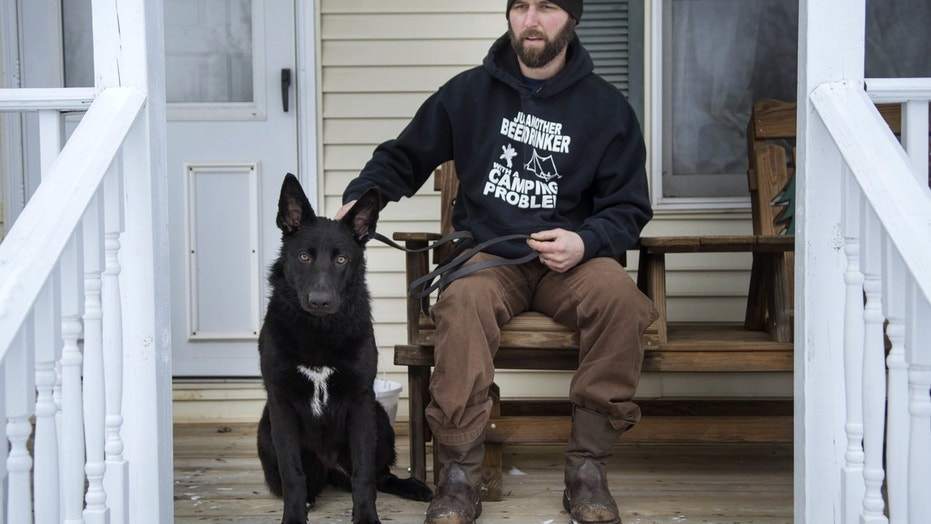 Former Marine saves mother, dog from freezing Michigan pond