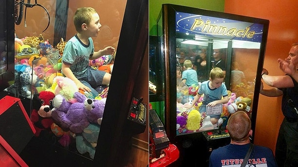 Firefighters help boy stuck in claw machine