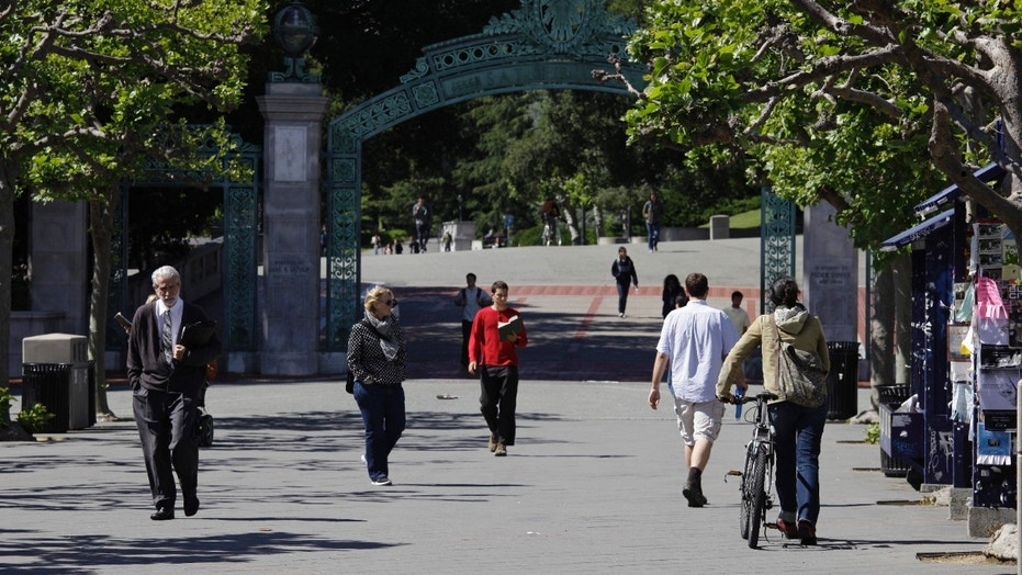 People walk near the Sather Gate on the campus of the University of California at Berkeley, June 1, 2011.