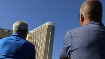 Tourists look up at the broken windows on the Mandalay Bay hotel from where shooter Stephen Paddock carried out his crime along the Las Vegas Strip in Las Vegas, Nevada, U.S., October 4, 2017.  REUTERS/Mike Blake - RC1995388F00