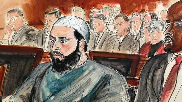 In this courtroom drawing, defendant Ahmad Khan Rahimi is seated during his sentencing hearing in New York, Tuesday, Feb. 13, 2018. Rahimi was sentenced to multiple terms of life in prison for setting off small bombs in two states, including a pressure cooker device that blasted shrapnel across a New York City block. At right is attorney Xavier Donaldson, Rahmin's attorney. (Elizabeth Williams via AP)
