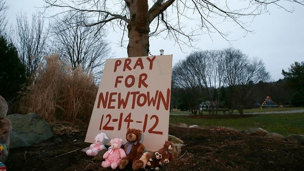 A sign stands at a makeshift memorial in Newtown, Connecticut early Sunday December 16, 2012. Twelve girls, eight boys and six adult women were killed in the shooting on Friday at the Sandy Hook Elementary School in Newtown.  REUTERS/Mike Segar   (UNITED STATES - Tags: CRIME LAW EDUCATION TPX IMAGES OF THE DAY) - GM1E8CG1L8301