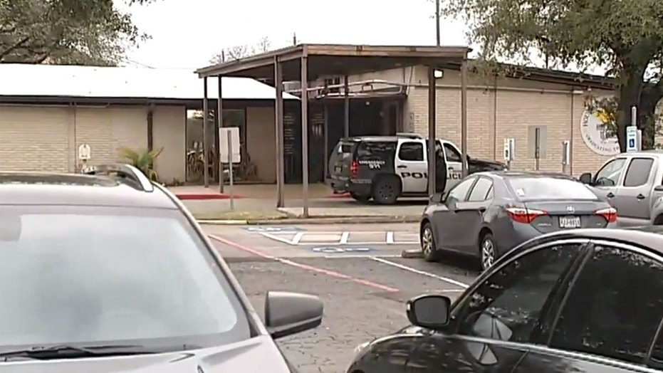 A school in Houston was placed on lockdown after a student brought a gun to the building in his hoodie, police said.