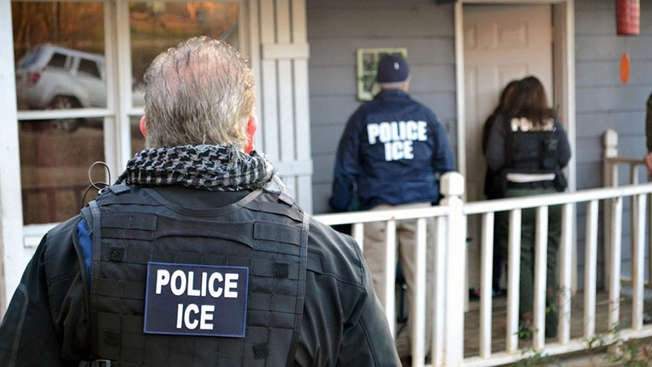 A file photo showing an ICE enforcement action in Atlanta one year ago, on Feb. 9, 2017.