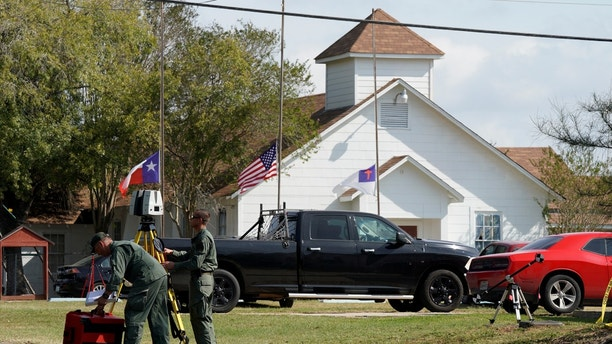 Officials with a scanner near the entrance of the site of the shooting at the First Baptist Church of Sutherland Springs, Texas, U.S. November 7, 2017.  REUTERS/Rick Wilking - RC1E19429300