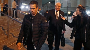"Joseph ""Skinny Joey"" Merlino, left, leaves federal court in Lower Manhattan after a mistrial was declared in his racketeering case, Tuesday, Feb. 20, 2018, in New York. Merlino, 55, was among nearly four dozen defendants arrested in a 2016 crackdown on the syndicate that prosecutors say committed crimes including extortion, loan-sharking, casino-style gambling, sports gambling, credit card fraud and health care fraud. (AP Photo/Kathy Willens)"