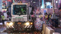 New York City Department of Sanitation workers clean the streets after the New Year celebrations in Times Square in Manhattan, New York, U.S., January 1, 2018. REUTERS/Amr Alfiky - RC185A1859A0