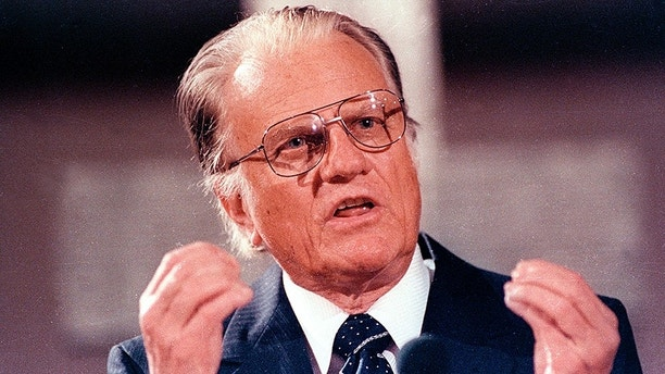 U.S. evangelist Billy Graham spoke in the East Berlin Gethsemane Church, center of last year's uprising on March 9, 1990. Graham was due to address a rally on Saturday in front of the old Reichstag parliament building at the wall in West Berlin.  REUTERS/Juergen Schwarz    BEST QUALITY AVAILABLE - GF2E4480MIT05