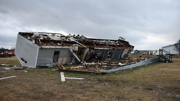 A mobile home is seen destroyed after a tornado struck an area outside Joshua, about 20 miles (32 kilometers) south of Fort Worth, Texas, Tuesday, Feb. 20, 2018. Two weak tornadoes have hit North Texas, demolishing at least one mobile home and damaging about a dozen others in the rural area near Joshua and damaging the roofs of homes in the Dallas suburb of DeSoto. (Jessica Pounds/Cleburne Times-Review via AP)