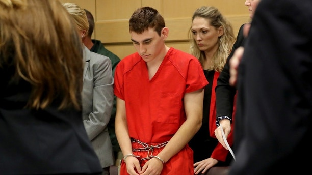 Nikolas Cruz, facing 17 charges of premeditated murder in the mass shooting at Marjory Stoneman Douglas High School in Parkland, appears in court for a status hearing in Fort Lauderdale, Florida, U.S. February 19, 2018.   REUTERS/Mike Stocker/Pool - RC1F13C2C8F0